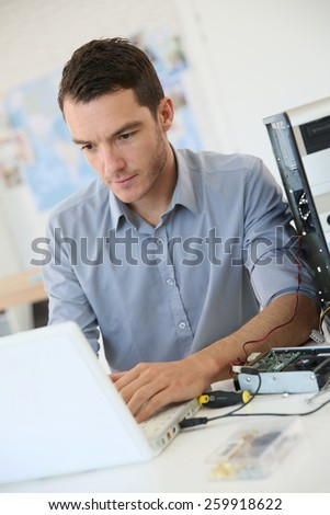 Engineer proceeding to data recovery from computer