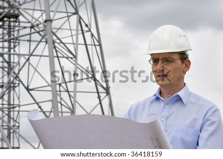 Engineer reading a plan on construction side