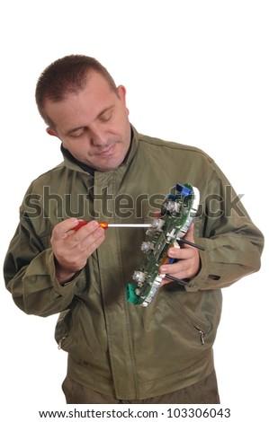 Engineer repairing circuit board, in computer equipment