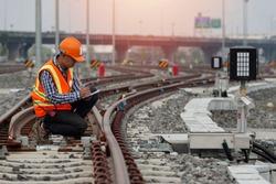 engineer Sitting on railway inspection. construction worker on railways. Engineer work on railway. rail, engineer, Infrastructure