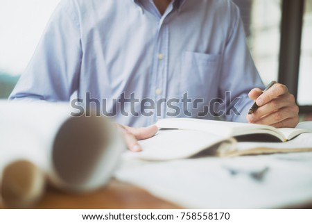 Engineer sketching architectural project on blueprint, engineering concept, architecture concept #758558170