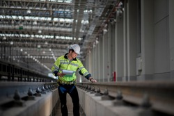 Engineer standing in depot  and railway inspection. construction worker on railways. Engineer work on railway. rail, engineer, Infrastructure
