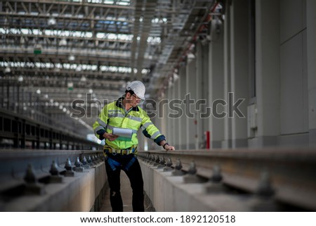 Engineer standing in depot  and railway inspection. construction worker on railways. Engineer work on railway. rail, engineer, Infrastructure Сток-фото ©