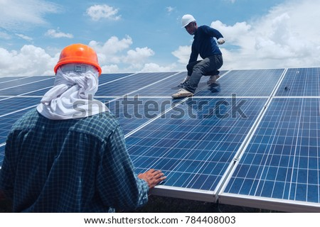 engineer team working on replacement solar panel in solar power plant;engineer and electrician team swapping and install solar panel after solar panel voltage drop #784408003