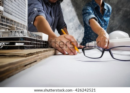 Engineer teamwork. Image of engineer meeting for architectural project. working with partner and engineering tools on workplace.