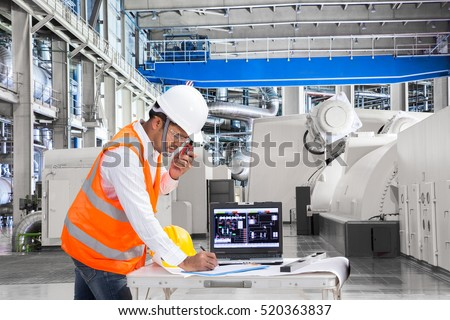 Engineer using laptop computer for maintenance equipment in thermal power plant factory #520363837