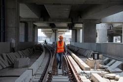 engineer walking on railway inspection. construction worker on railways. Engineer work on railway.rail,engineer,Infrastructure