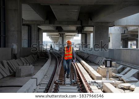 engineer walking on railway inspection. construction worker on railways. Engineer work on railway.rail,engineer,Infrastructure Foto stock ©