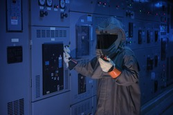 Engineer wear a arc flash protection suit for inspection electrical current   and checking status switch gear electrical energy distribution substation.
