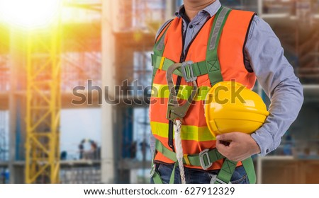 Shutterstock engineer wear fall arrest equipment on site  background