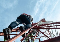 Engineer wear safety equipment climb high telecom tower for maintenance 5G network.Working with risk work.