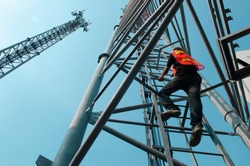 engineer wear safety equipment climb high tower for working telecom maintenance.