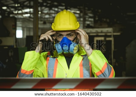 engineer wearing a gas mask on his face working in industrial factory.worker engineer industry.engineer workplace in industrial company with mechanical engineering.