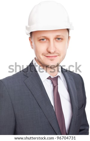 Engineer with white hard hat standing confidently isolated on white background