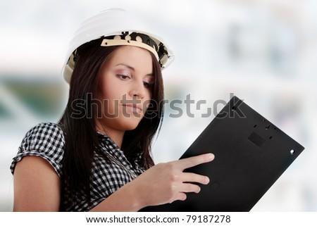 Engineer woman in white helmet