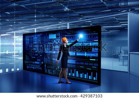 Engineer woman using virtual panel #429387103