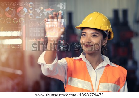 Engineer worker using advance technology digital hologram infographics touch panel in industry factory. Foto stock ©