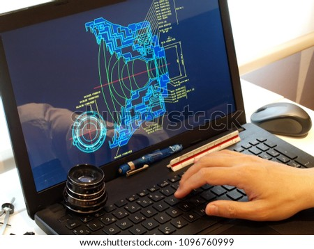 engineer working at computer at optical prototype scheme design