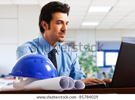 Engineer working at his laptop in the office - stock photo