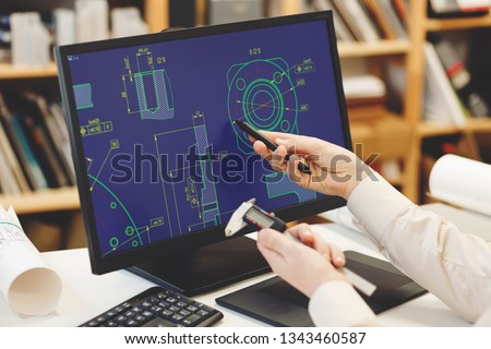 Engineer working on cad scheme using computer tools. #1343460587