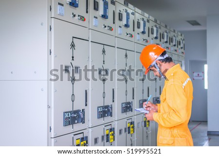 engineer working on checking and maintenance equipment at green energy solar power plant: cheking status switchgear