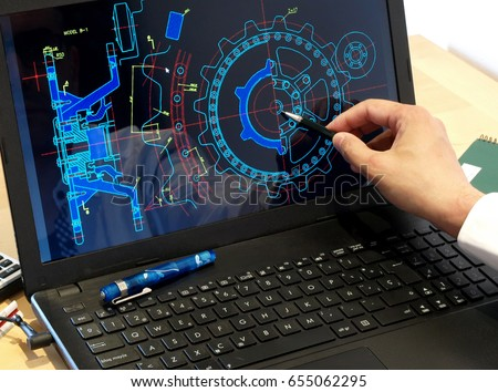 engineer working on computer at the design of mechanical piece   #655062295