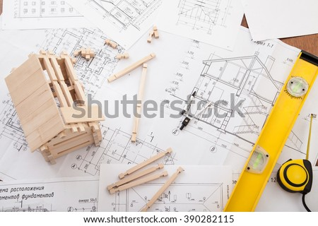 Engineer working on drawings, concept of building house