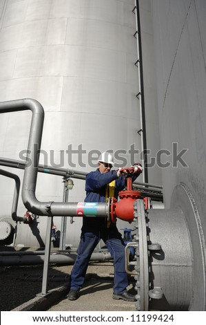 engineer working on pipelines inside large oil refinery