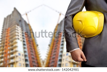 engineer yellow helmet for workers security over two high-rise buildings