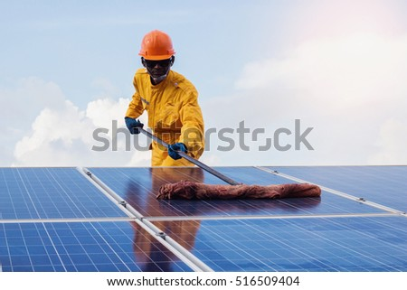 engineering employee man Repair of solar cell.the concept of cleaning on solar cell.