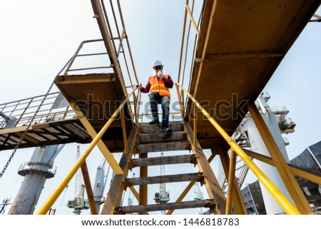 engineering foreman, supervisor, master controller in working place, command working area for safety