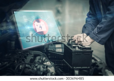 Engineering interface against mechanic changing car battery #303696485