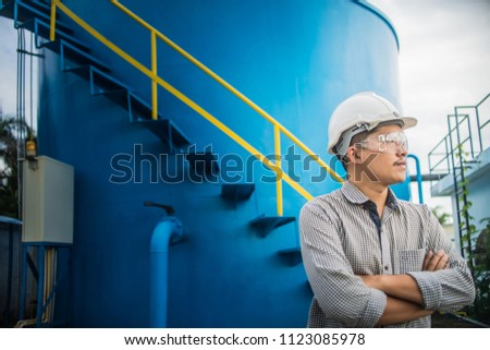 Engineering Man wearing white hard hat at Natural gas processing facility, oil and gas maintenance and service #1123085978