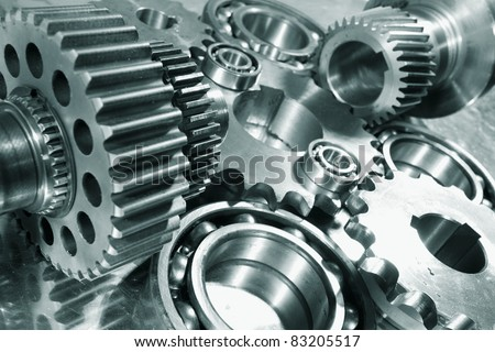engineering parts arrangement blue toning concept focal-point on the large closest gear