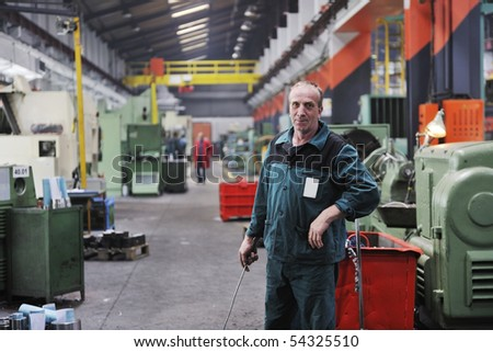 engineering people manufacturing industry with big modern computer machine