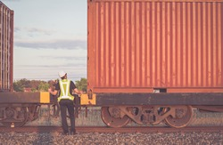 Engineering working  in front of cargo loading workplace, Freight train