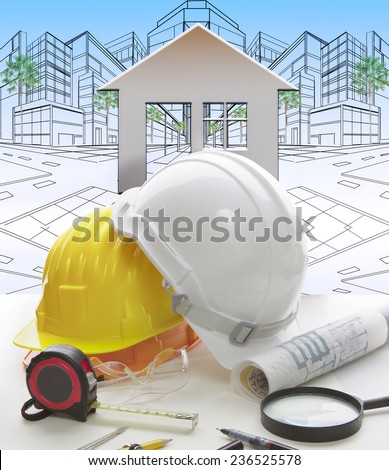 engineering working table writing tool ,equipment ,and safety helmet against two point perspective of building exterior