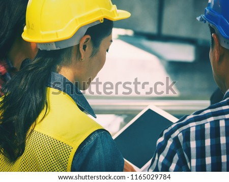 Engineerman and women are look project and planning with ipad.