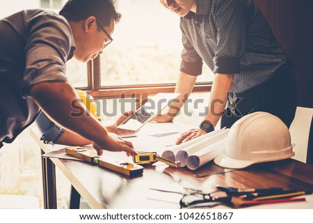 Engineers and businessmen are discussing construction projects in workplace. Construction concept. stock photo