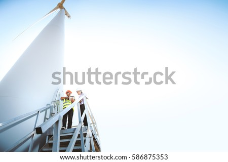 Engineers are monitoring the wind turbine system.