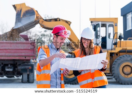 Engineers examining plans on construction site #515524519