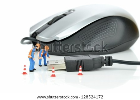Engineers inspecting the usb plug of a computer mouse