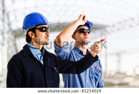 Engineers looking at something in a construction site