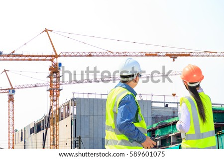 Engineers on site construction of high buildings.