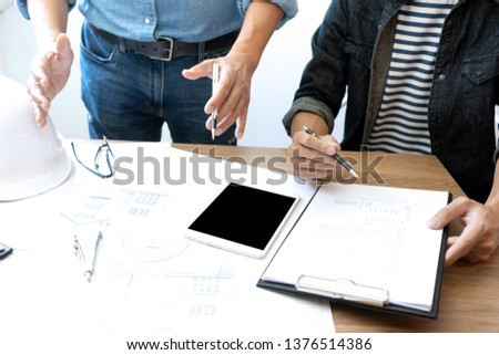 engineers or architects  discussing and working on blueprint with architect equipment, Construction engineer or architectural project  concept. #1376514386