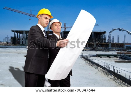 engineers supervising construction site