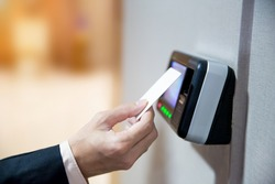 Engineers using key card to identity verification for access the door or entre the security room.