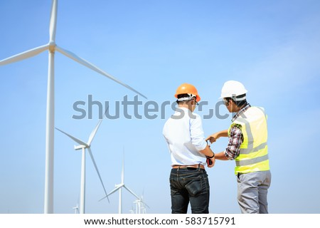Engineers windmills for production of electric power. #583715791