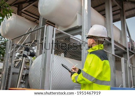 Engineers work place to keep liquid helium,preventive maintenance schedule checking,Thailand people Stock fotó ©