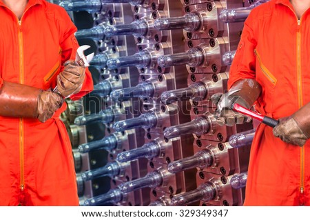 Engineers worker holding the tools on Industrial equipment of PET preforms background, industry concept
